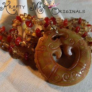 Handcarved Soapstone Dragon Hanging in the Amber Glass Necklace Set