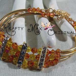 Golden Glow Swarovski Crystal and Gold Plated Triple Strand Bracelet