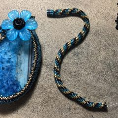 Jaguar Teal Necklace (working), Blue and Yellow Butterfly Bracelet and Lions Seafood Festival