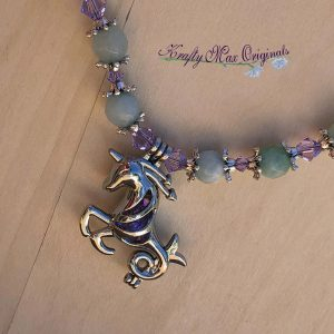 Purple Swarovski Crystals and Blue Gemstones Matched with a Unicorn Bead Cage Necklace Set