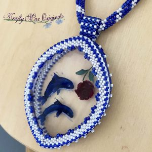 Blue Dolphin and Rose Necklace